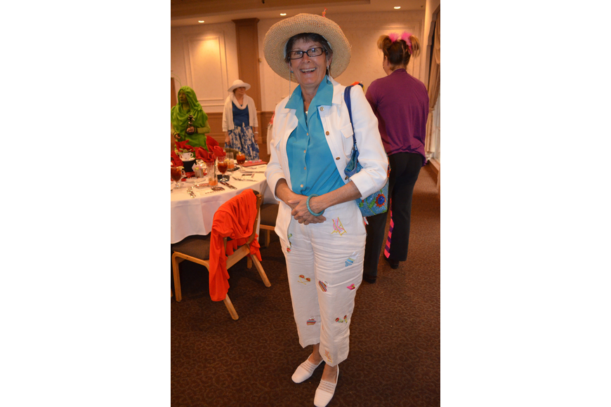 Terri Nowes wears a hat-themed outfit.