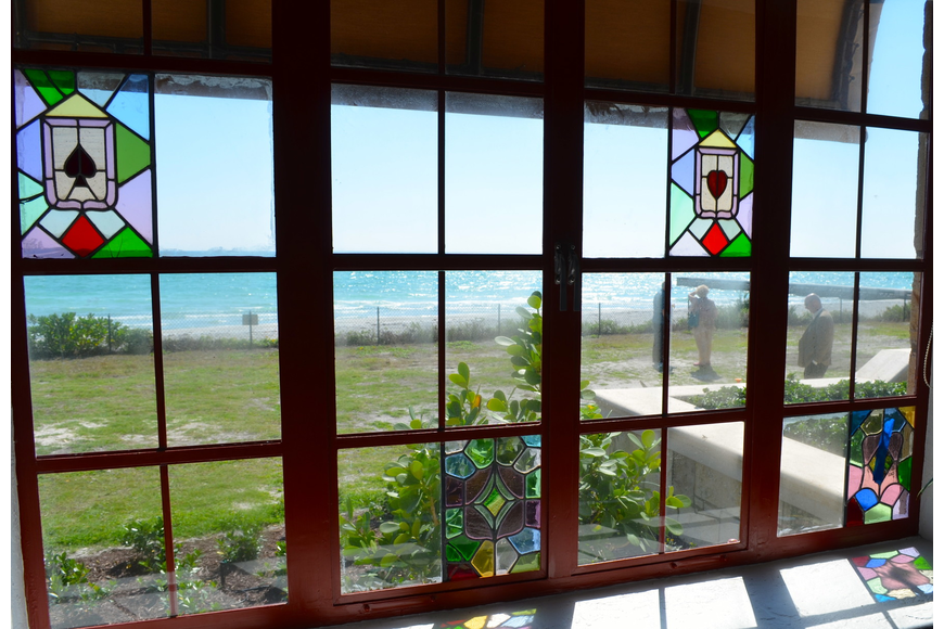 Restored stained-glass windows offer views throughout the home.