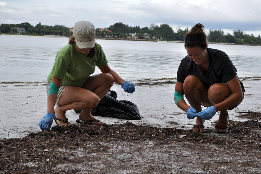 Dana Henderson and Gina Santoianni cleanup trash over in the boating and fishing area Thursday, Sept. 8, at Ted Sperling Park.