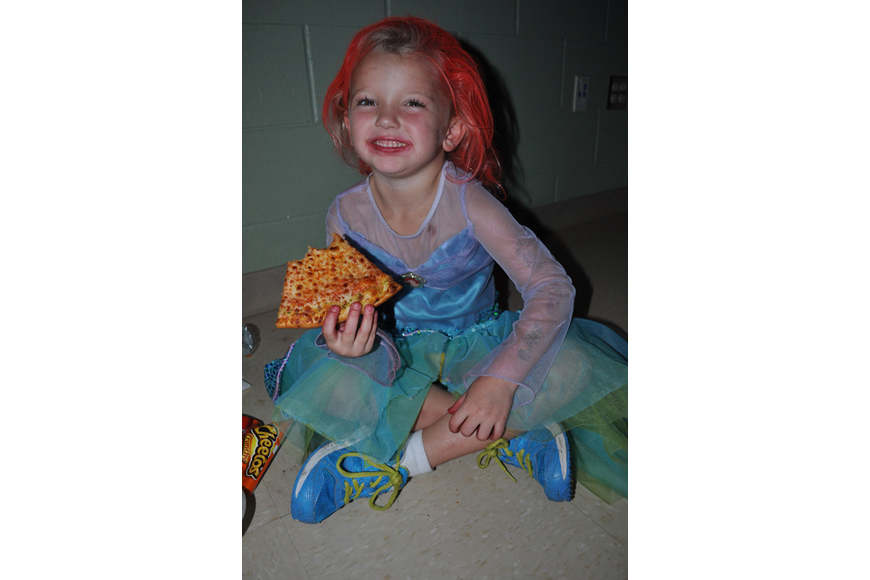 Ella East, 5, ate pizza with her twin sister, Addison, not pictured.