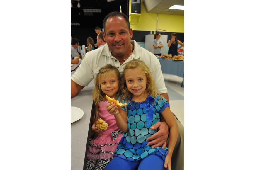 Morgan and Natalie Fellows feasted on doughnuts with their dad, George.