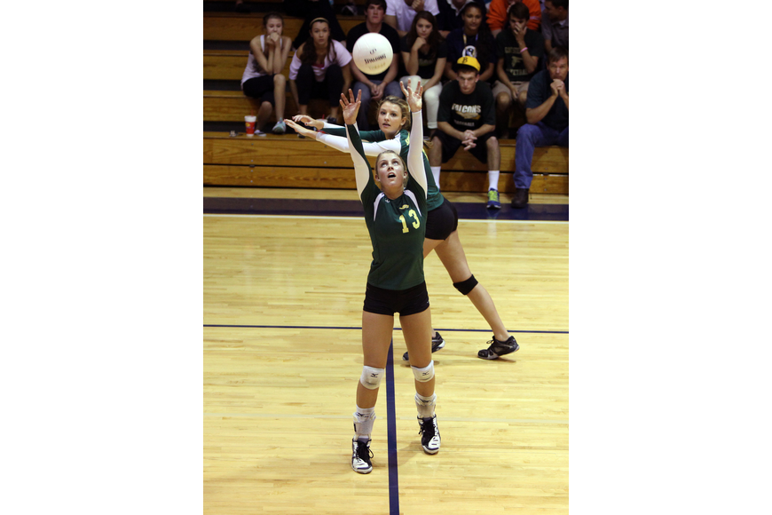 Natalie Marciniak, No. 13, sets the ball.