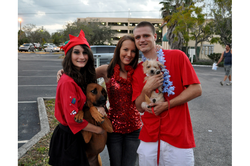 Janeen Pilafian, Carissa Barnes and Jordan Lee with their dogs, Brandy Michelle and Nyla.