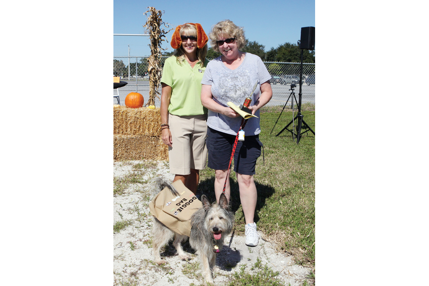 Executive Director of HSSC Kristie Dorman with Lisa Meneses and the winner of the most creative costume award, Lucy.