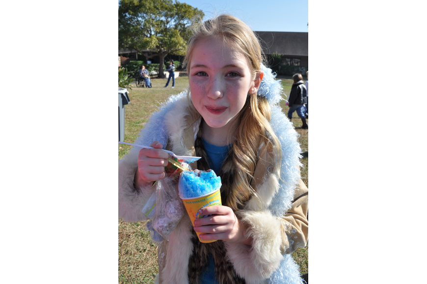 Ainsley Hunihan, 9, loaded up on sweet treats after sledding at The Tabernacle's event.