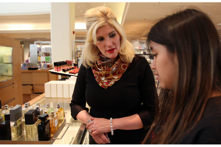 Dawn Patterson talks with Girls Inc member Erika Sanchez about Chanel perfumes.