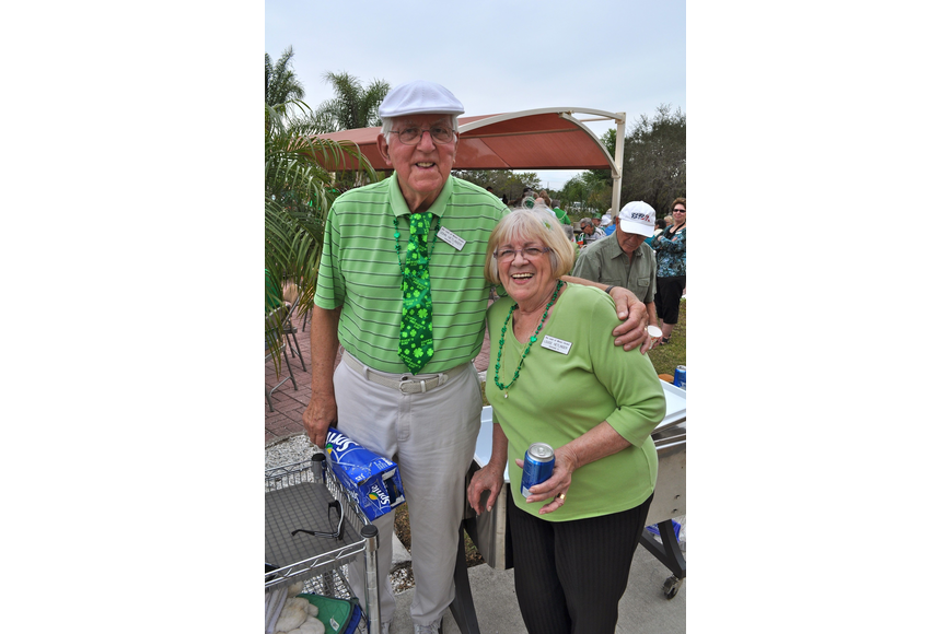 John and Louise Hetlinger wore their best green attire to the party at Our Lady of Mount Caramel Parish.