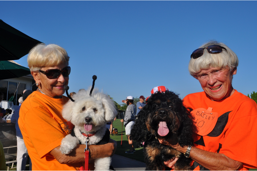 Parade committee leaders Gina Garis and Doris Collins with Brandy and Bailey