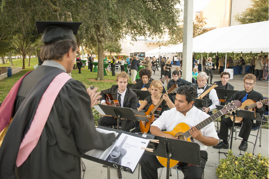 Rex Willis directs SCF's Guitar Ensemble at the reception following the inauguration of SCF President Dr. Carol F. Probstfeld.