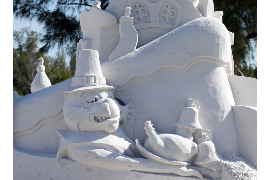 A sand Grinch created by Brad Goll and John Woodworth. Their sand sculpture was entitled