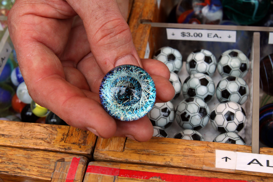 Jack Hahn, the Marble Man, shows off one of his more elite marbles at the 17th annual Siesta Key Craft Festival Saturday, Feb. 5, in Siesta Key Village.