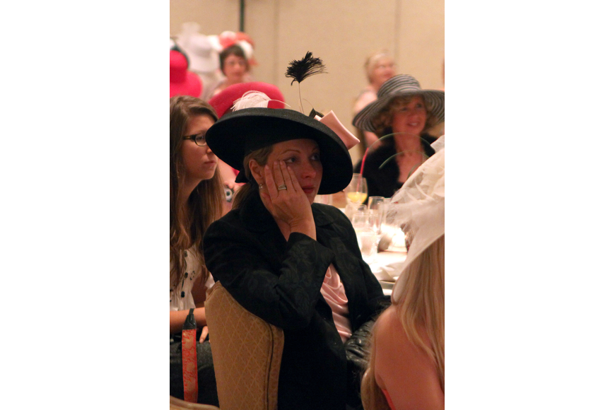 Suzanne Willis wipes a tear from her cheek while watching the royal wedding Friday, April 29 at the Ritz Carlton.