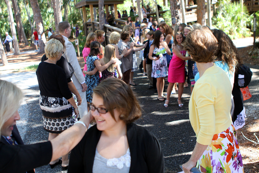 Lower School teachers made two lines on either side of the walk way down from Siesta Key Chapel in order to personally congratulate all the kids Friday, June 3 after ODA's 6th grade graduation at Siesta Key Chapel.