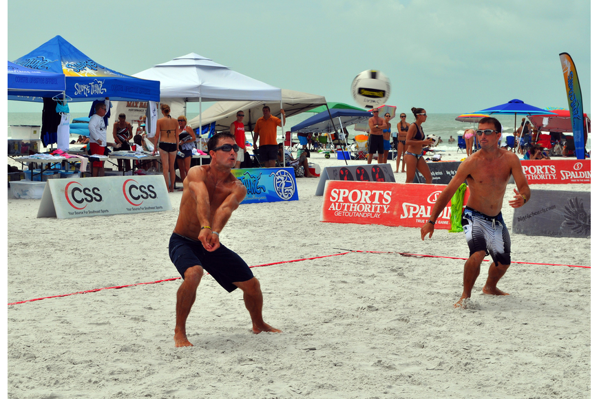 Chris Sweat prepares to hit the ball while his brother and teammate, Nick, stays on his toes during the Siesta Key Gulf Open, Saturday, July 9 at Siesta Key Beach.