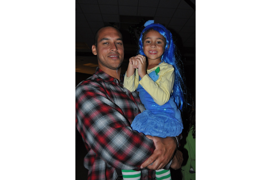 Ben Morgan gave his daughter, Mia, a better spot from which to watch the costume contest.