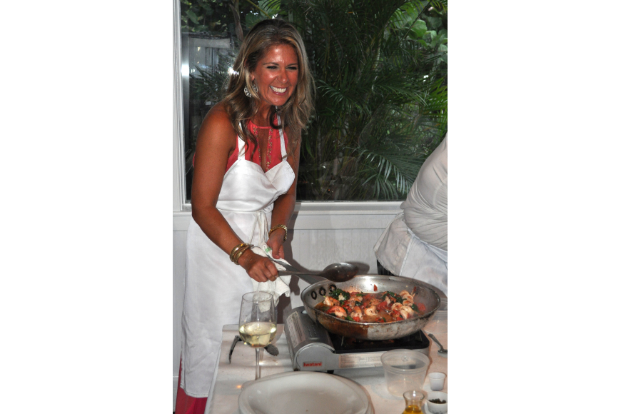 Chris McKee has fun cooking during the Taste of the World Interactive Dinner, Friday, Aug. 17, at Pattigeorge's.