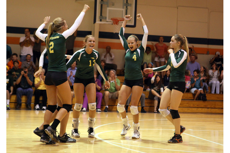 St. Stephen's lady volleyball players rejoice on the court after they realize they have won the game.