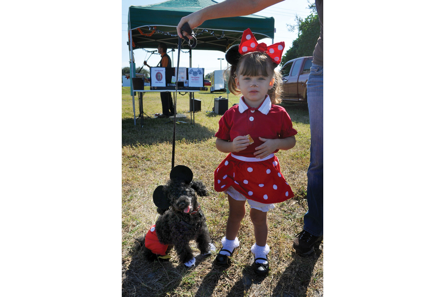 Poe, 9, dressed up at Mickey Mouse to match Charlotte Machado, 2, who dressed up as Minnie Mouse for the Phillippi Farmhouse Market Howl-O-Ween. Poe and Machado won Best Owner/Dog Look Alike.