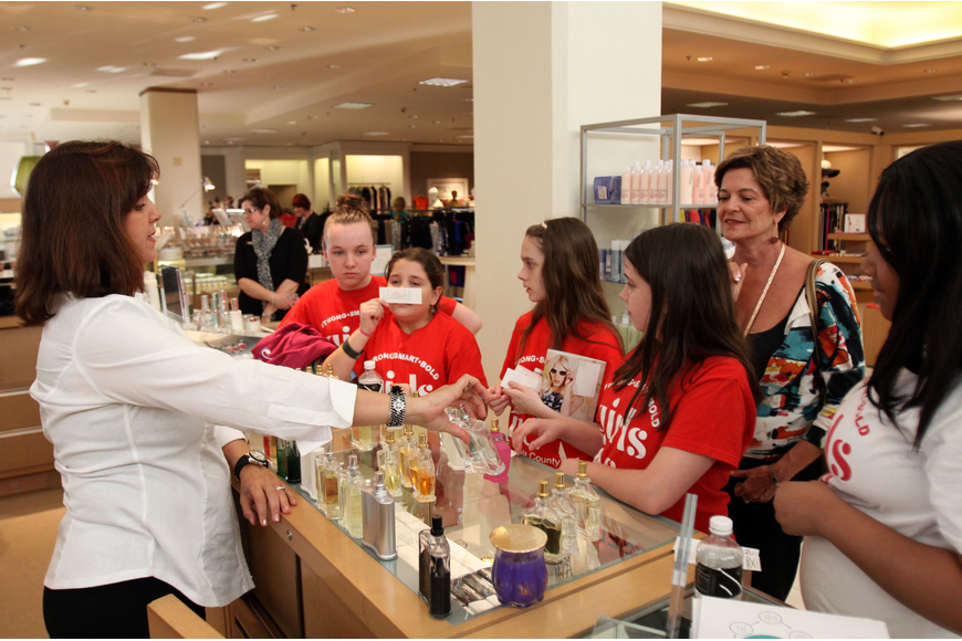 Randi Greenfield lets the girls smell a variety of different perfumes.
