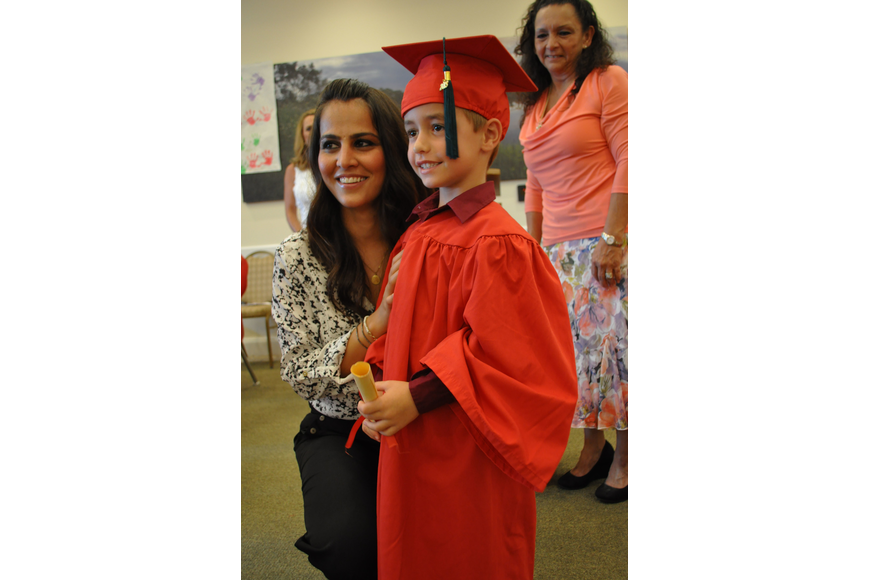 Teacher Shagolfa Hassanzadeh poses with Parker McElyea.