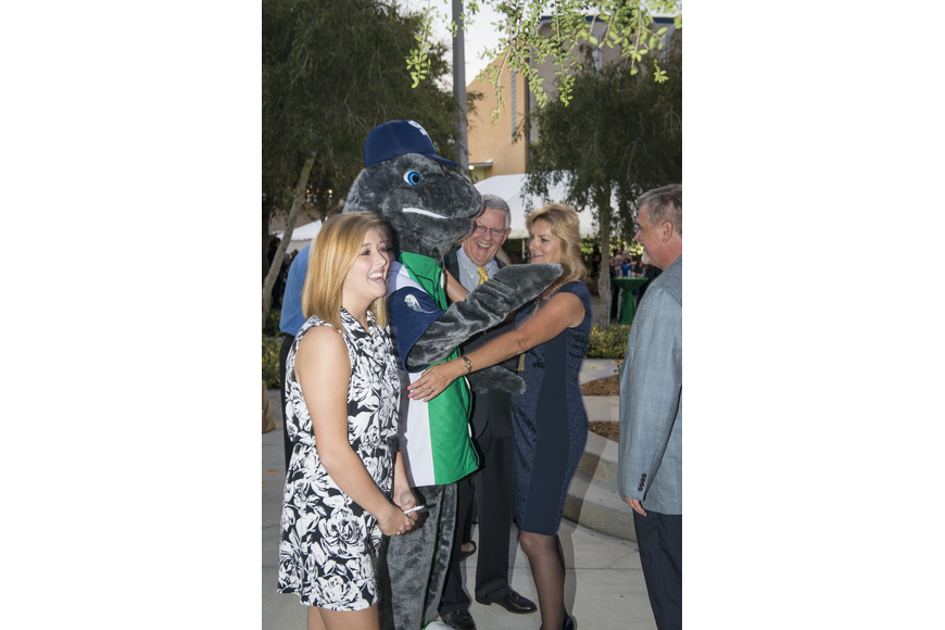 SCF President Dr. Carol F. Probstfeld and her husband, William A. Murphy, greet SCF's mascot, Maverick the Manatee, at the inauguration reception as Steve Prouty, SCF general counsel, and SCF students look on.