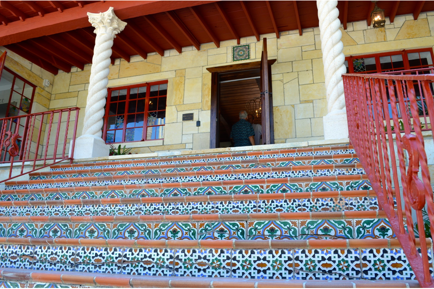 Tiled stairs lead to the front door.