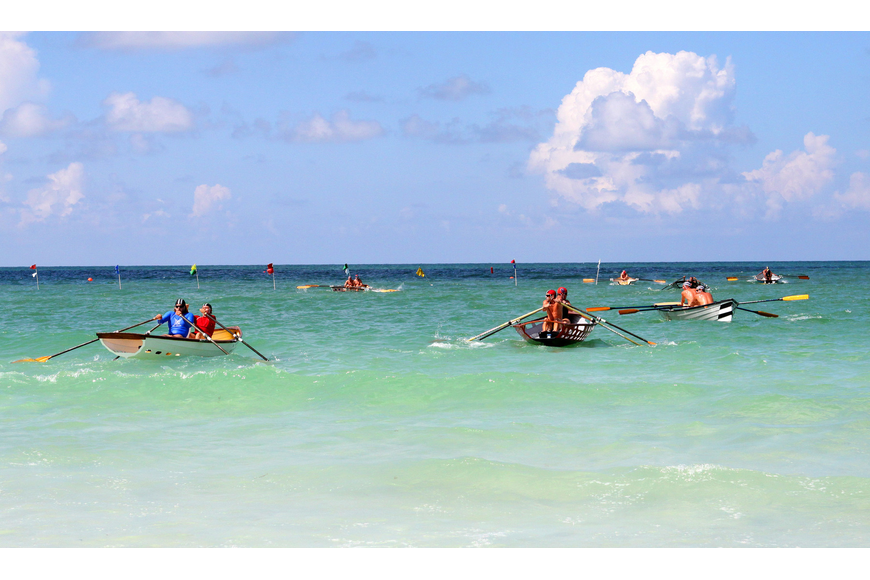 A handful of dories head out into the Gulf of Mexico Thursday, July 14 during the 2011 James