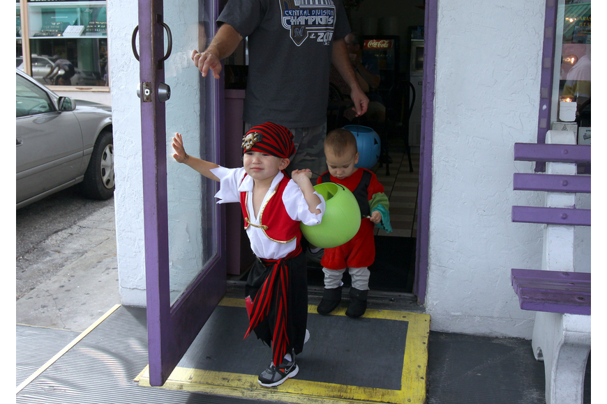 JR, 3, and Rocco, 1, Ryan leave Big Olaf after getting some treats, Monday, Oct. 31, during the Safe Kids trick-or-treating event in Siesta Key Village.