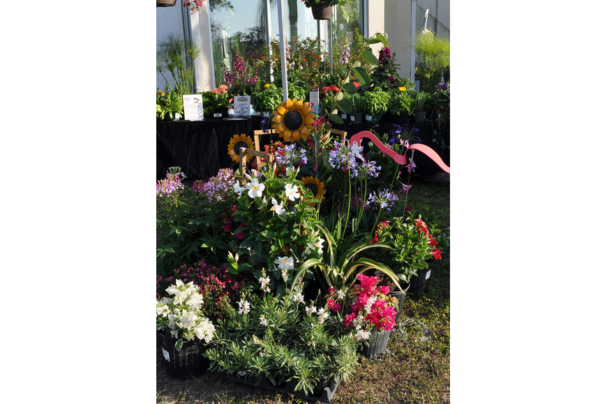 Beautiful flowers, arrangements and garden art from The Plant Place were on display outside of G.Wiz in the Marketplace at the Second Annual Simply Sarasota Kitchen and Garden Festival.