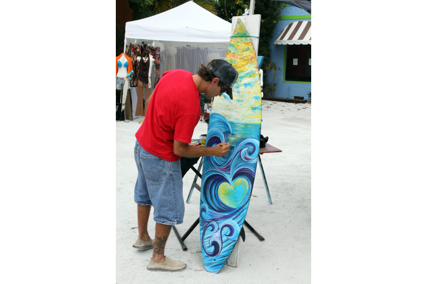 Cheeta Chad Ruis works on a piece of his artwork during Siesta Fiesta, Saturday, April 14.