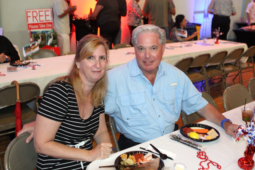 Ruth Ann and Mike Steele enjoy some food at the kickoff party, Saturday, June 23, at the Sarasota Municipal Auditorium.