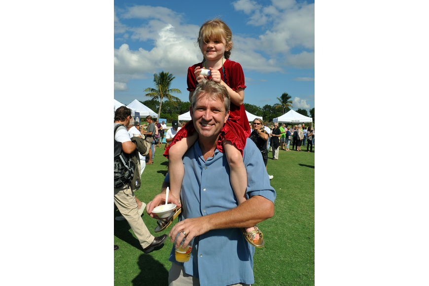Bryce Hurley gives his daughter Eden, 4, a ride on his shoulders.