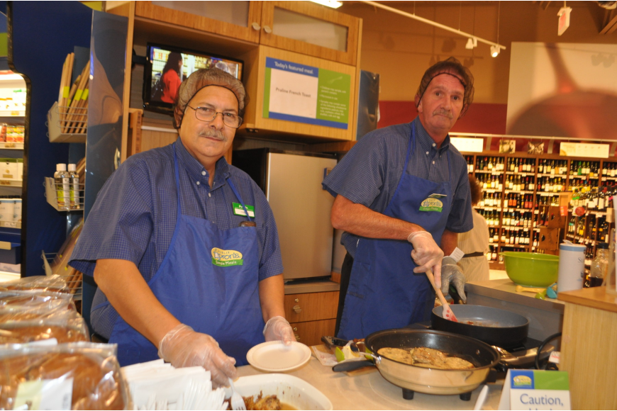 Publix associates Yani Temenos and Tim Sabo prepare the first Apron's Simple Meal selection of praline French toast.