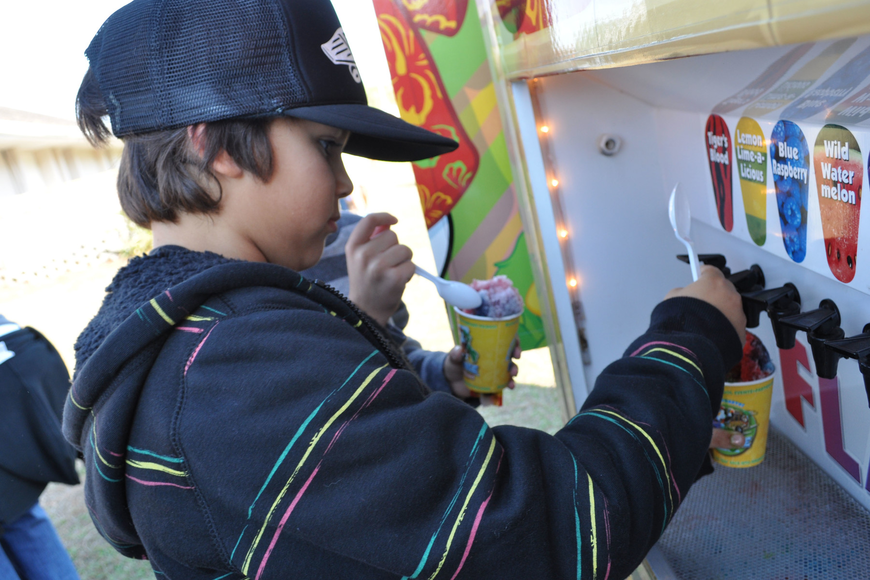 Justin Worley added all the flavors to his sno-cone, at the Tabernacle's Winter Wonderland.