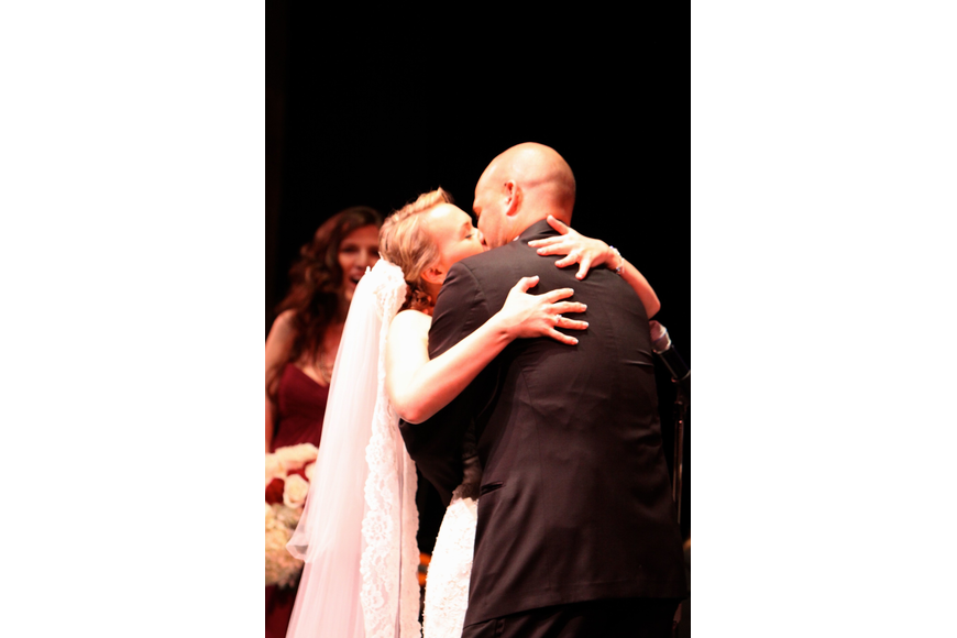 Emily Forbes and Joseph Sckowska share in their first kiss as Mr. and Mrs. Sckowska.