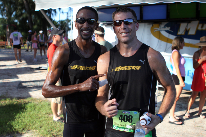 Marcus Dumas and John Blewis pose together after finishing the Siesta Key Triathlon Saturday, July 23 out at Siesta Key Public Beach.