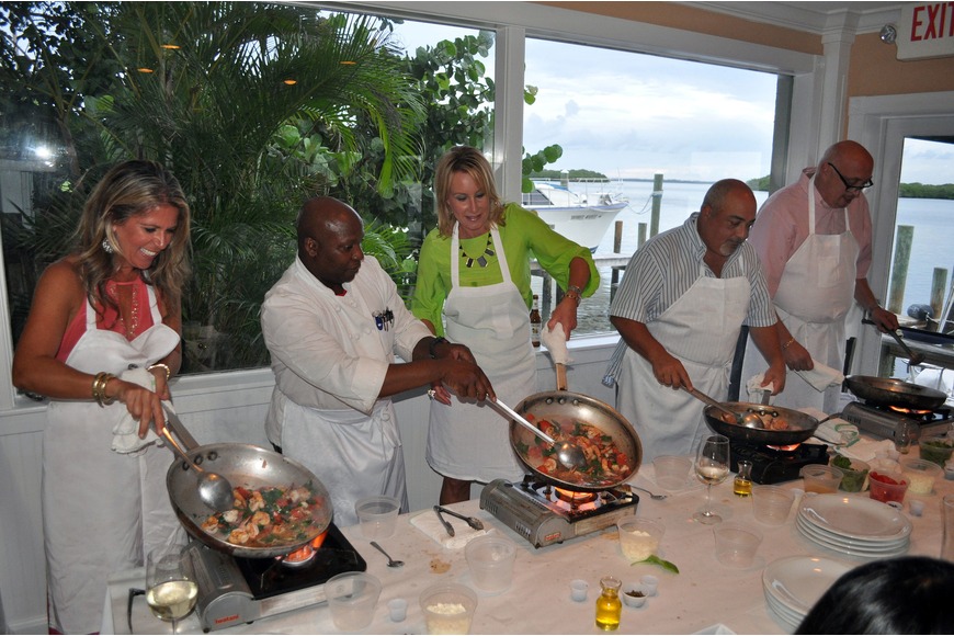 "Thomas Petit helps the table of Chris McKee, Jen Allen, Frank Nocco and ""Big Mike"" Levine during the Taste of the World Interactive Dinner, Friday, Aug. 17, at Pattigeorge's."