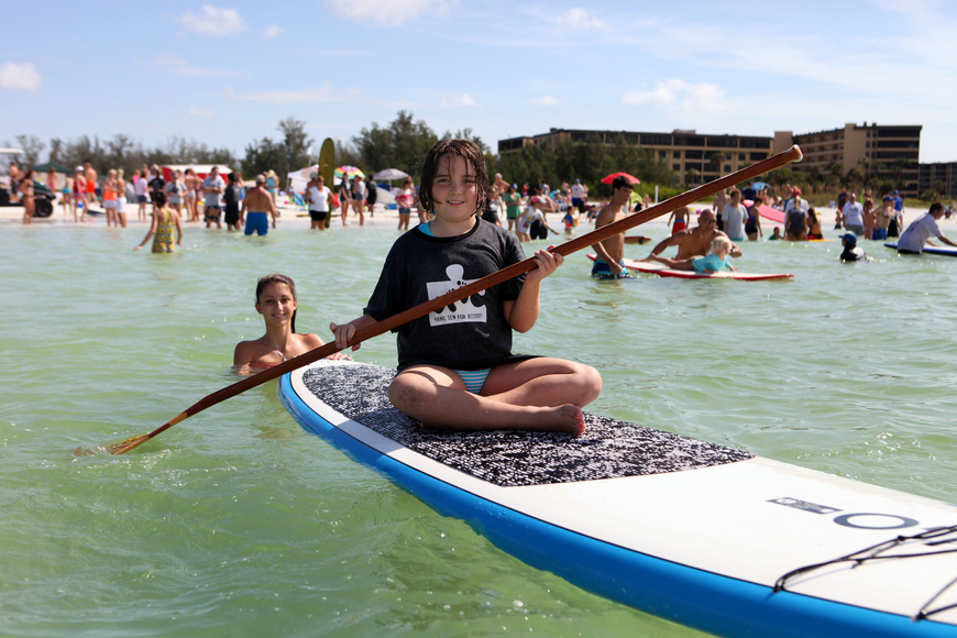 Molly Pyott, 8, tries out paddleboarding.