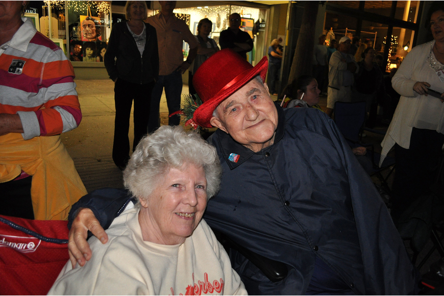 Sue and Fred Menke enjoy watching the parade from the sidewalk.