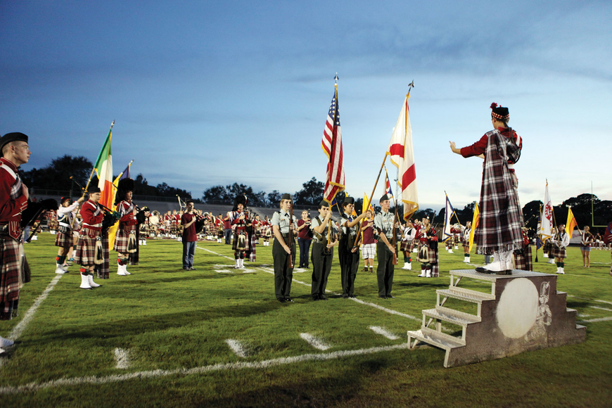 Current members and alumni of the Kiltie band perform during pre-game festivities at Riverview's homecoming game.