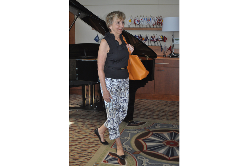 Anne Wood struts through the Sarasota Yacht Club dining room