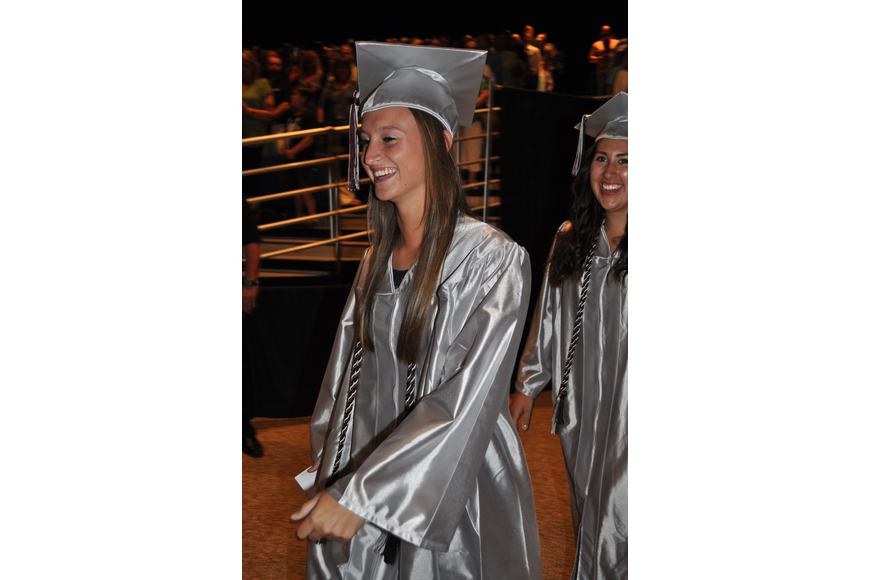 Ashley Allard couldn't contain her excitement as graduates entered the auditorium.