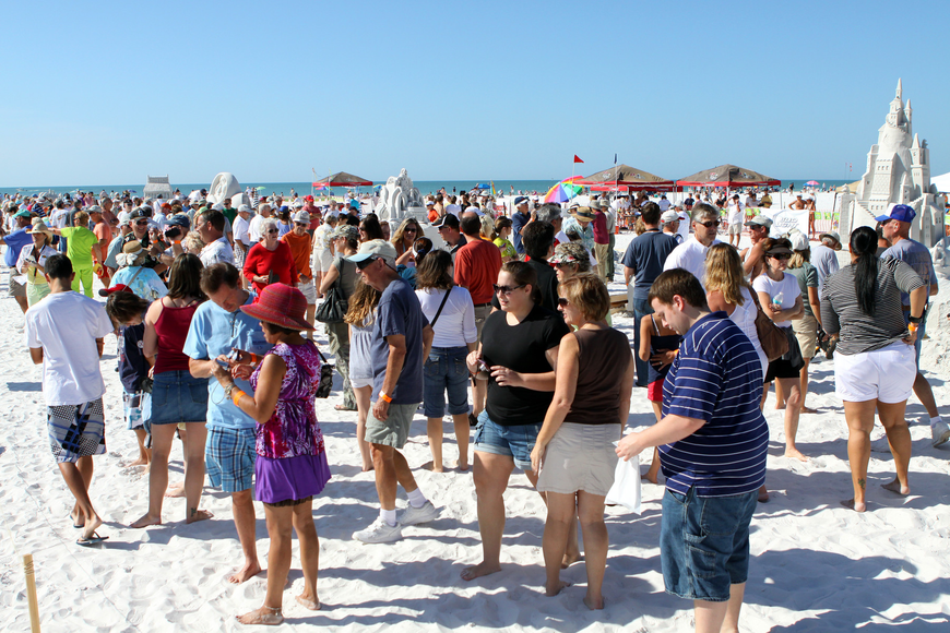 People wander around viewing the sand sculptures at the Siesta Key Crystal Classic.