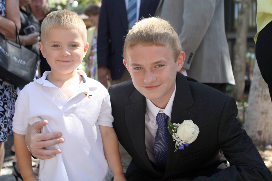 Caleb Cheney, 3, poses with his newly graduated brother, Cody, Friday, June 3 at ODA's 6th grade graduation at Siesta Key Chapel.