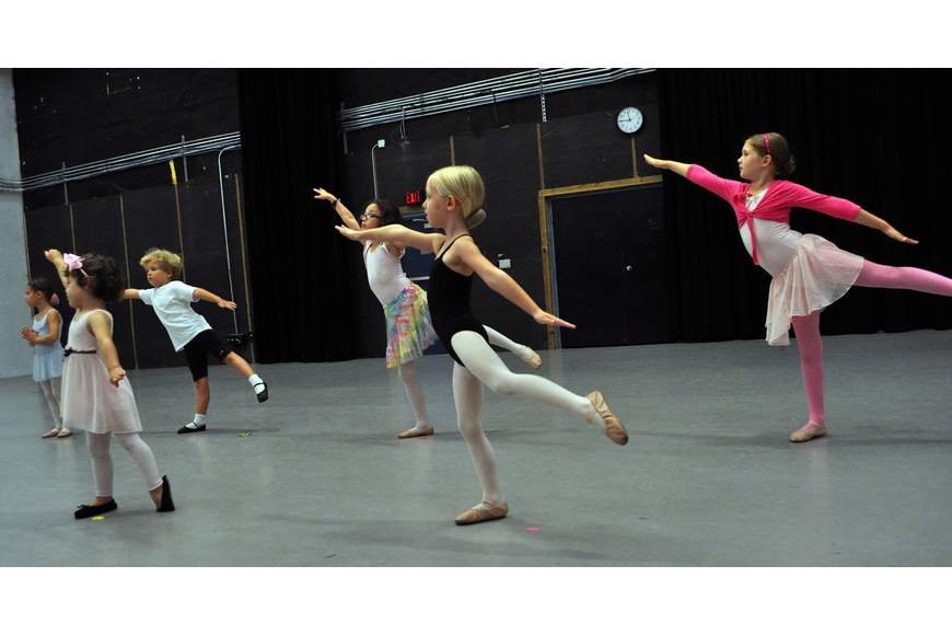 Young ballerinas work on their routine during a summer camp class run by the Sarasota Ballet at the Asolo Repertory.