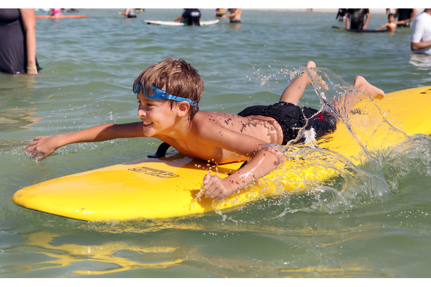 Julian Repetto, 8, paddles back out from shore Saturday, Sept. 15 at Hang 10 for Autism. This was Repetto's third time participating in Hang 10 for Autism.