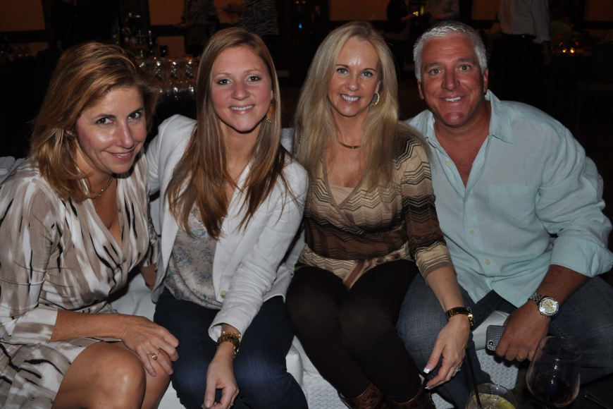 Nicole Penland and Laura Cappiello with Therese and Ron Masseo.