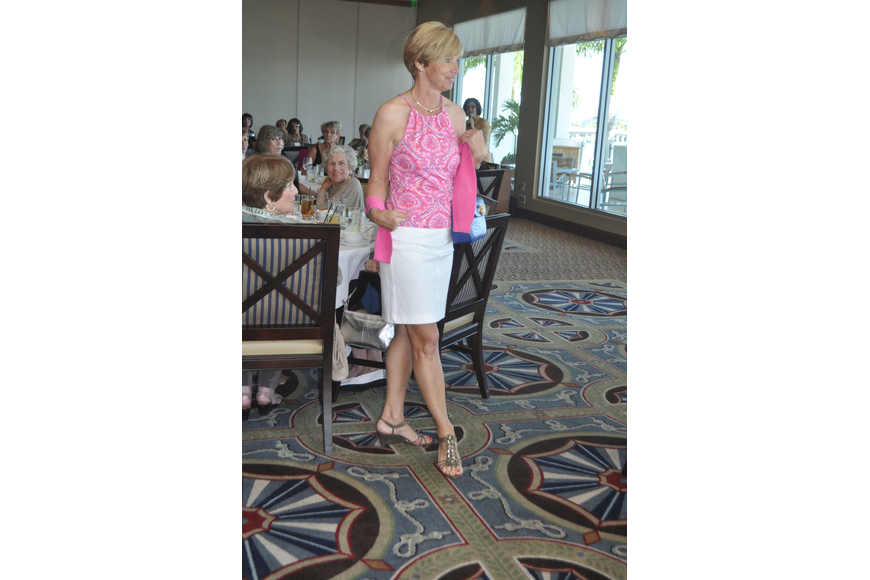 Regina Repenning struts through the Sarasota Yacht Club dining room