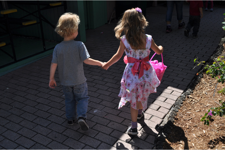 Raistlin, 4, and Kaylee, 6, Zerby run hand-in-hand down a path at Jungle Gardens.