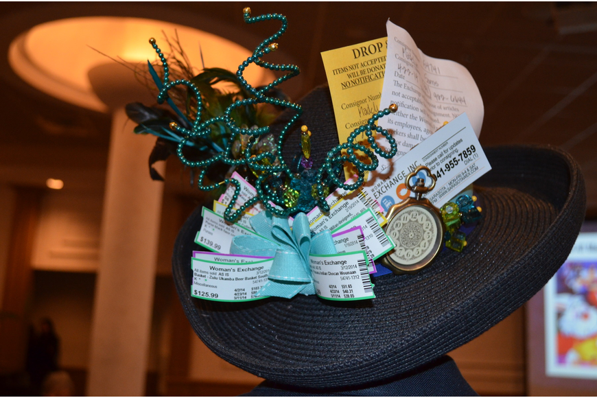 Madelyn Sams's hat includes volunteer tickets and intakes from her volunteering.